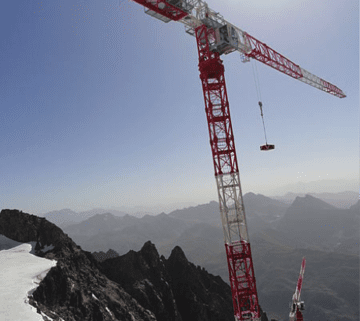 crane on the side of a mountain with high winds