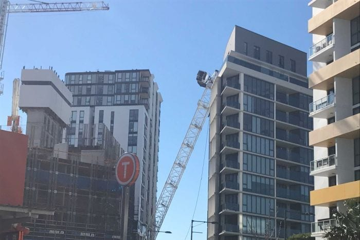 Crane collapses onto apartment block at Wolli Creek